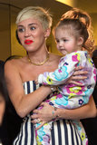 Miley Cyrus Sports Stripes at a Special Kids' Event With Ryan Seacrest