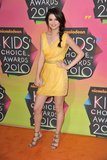 Selena Gomez kept it playful — and colorful — in a short yellow Christian Cota dress, Sergio Rossi heels, and a Lauren Merkin clutch at the 2010 Kids' Choice Awards.