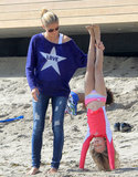 Heidi Klum helped her daughter Leni Samuel practice her handstands in Malibu on Saturday.