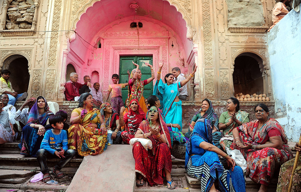 Hindu devotees celebrated outside at the Radha Rani Temple during the Lathmar Holi festival in Barsana, India.
