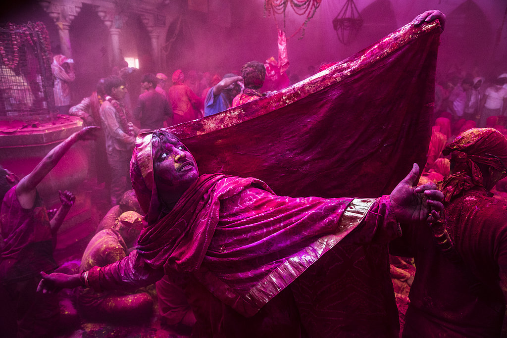 A transgender Hindu devotee danced during Lathmar Holi celebrations in the village of Barsana, near Mathura, India.