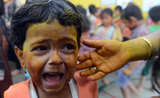 A young student cried after being smeared with colors during Holi celebrations at a city civic school in Mumbai, India.