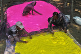 Laborers prepared colored powder for Holi on the outskirts of Siliguri, India.