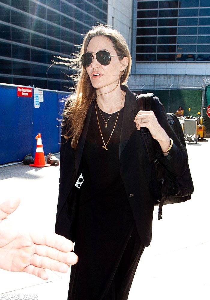 Angelina Denies Wedding Ring Rumors Upon Returning to LA