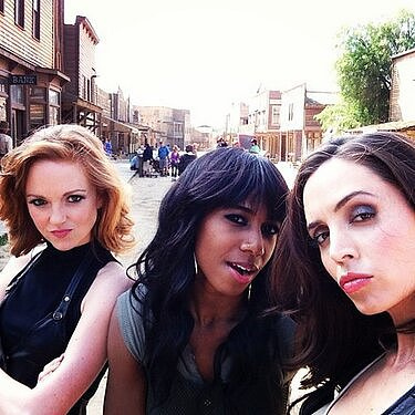 Eliza Dushku posed with her costars on set. Source: Twitter user elizadushku