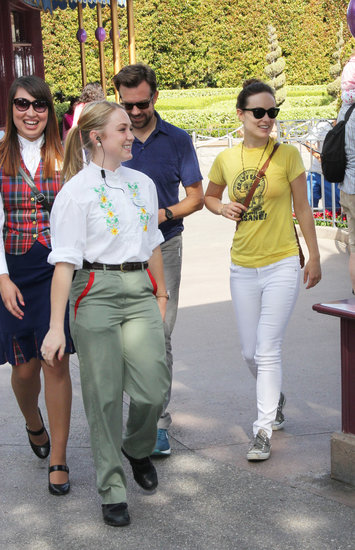 Olivia Wilde and Jason Sudeikis walked through Disneyland.