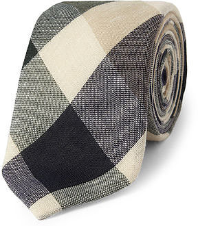 I'm one of those guys who will wear a tie to the office just because he feels like it. Alexander Olch is arguably my favorite company putting out ties right now, and this plaid cotton tie ($150) will look good with everything from a chambray shirt on the weekends to a suit at the office.  — Robert Khederian