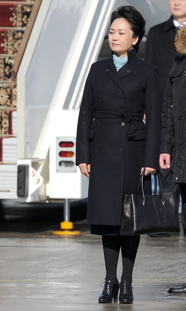 The website for the designer of this black trench coat went down after she wore it during her visit to Russia.