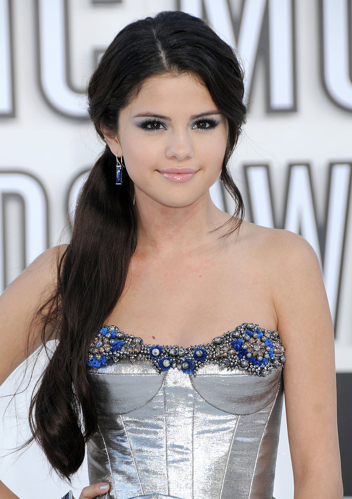 Selena's love for eye makeup was clear at the MTV Video Music Awards, where she matched her shadow to the embellishment on her dress. The look was complete with an extra-long ponytail.
