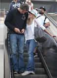 Kristen Bell grinned from ear to ear while arriving at LAX with Dax Shepard in July 2008.