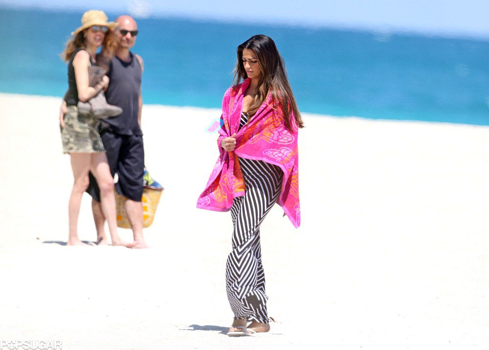 Camila Alves stayed warm in a printed wrap on the beach.