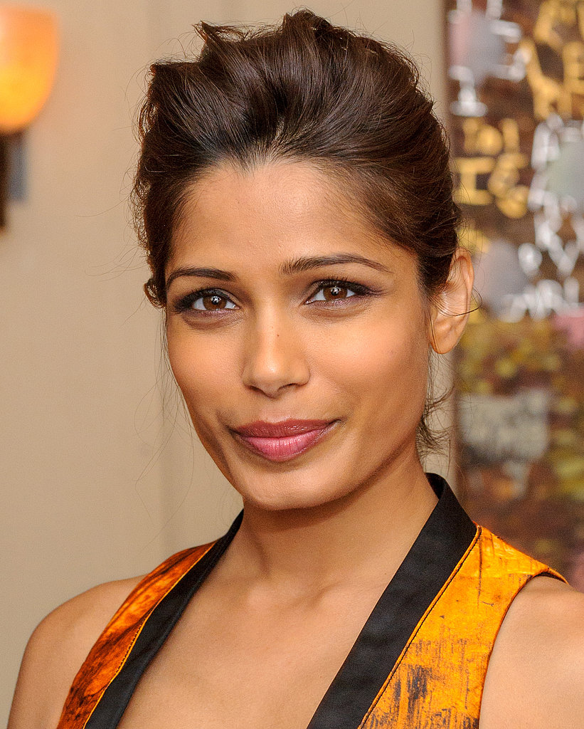 Freida Pinto styled her hair in a low chignon with tousled texture at the top. And her natural-looking palette was complete with a pretty pink pout.