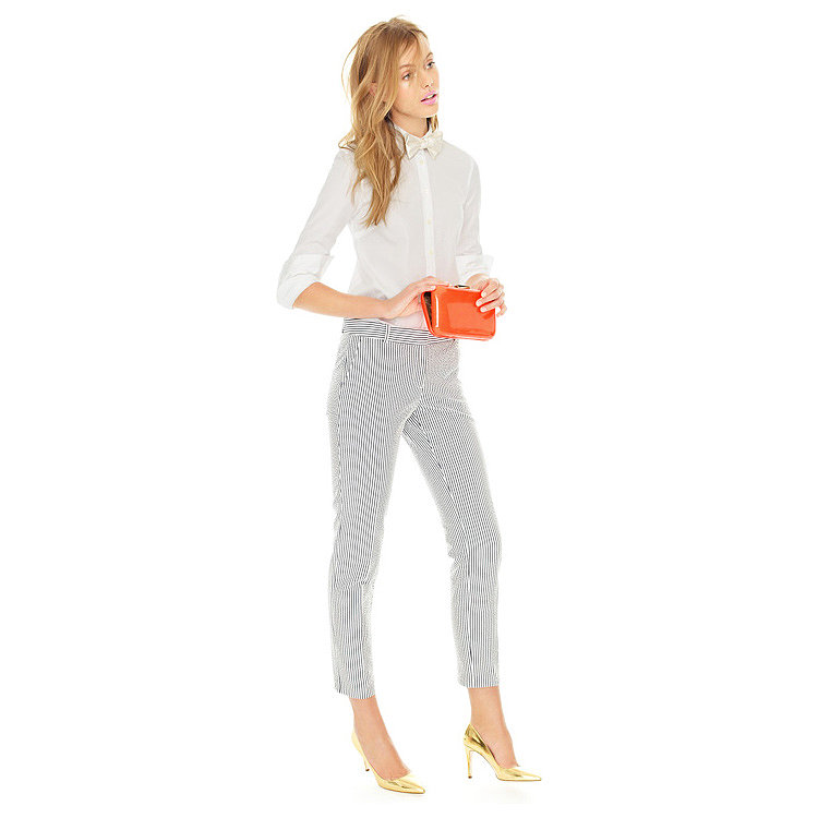Spring staples, like a white cotton shirt and striped pants, can easily be dressed up for night with just a few key accessories: a bright clutch, metallic pumps, and a chic bow tie.