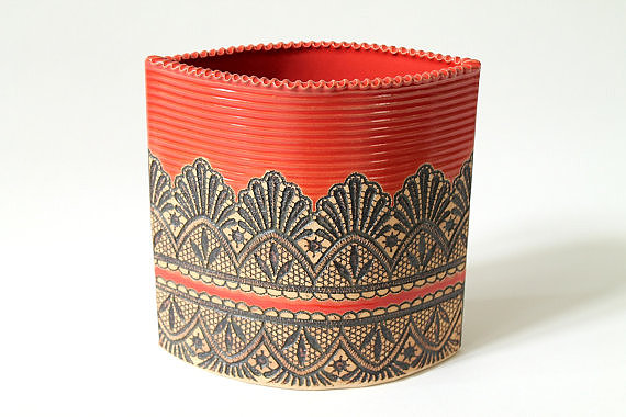 Imprinted with a lace design and boasting a vibrant coral color, these Moroccan-inspired planters ($100) come in two sizes and are made to order.
