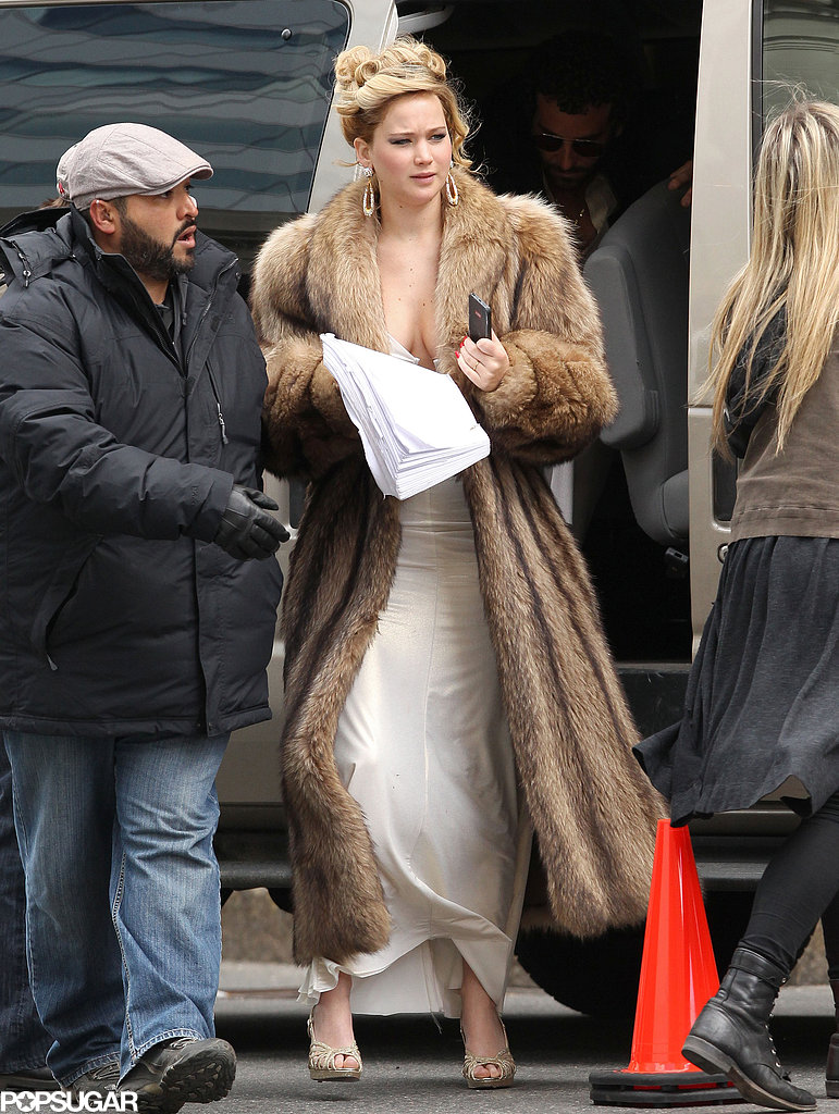 Jennifer Lawrence sported a floor-length fur jacket on set in Boston.