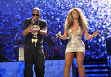 The duo performed on stage together in New York in 2010 — Jay-Z kept it edgy in a black printed tee and Beyoncé took the stage in a metallic minidress.