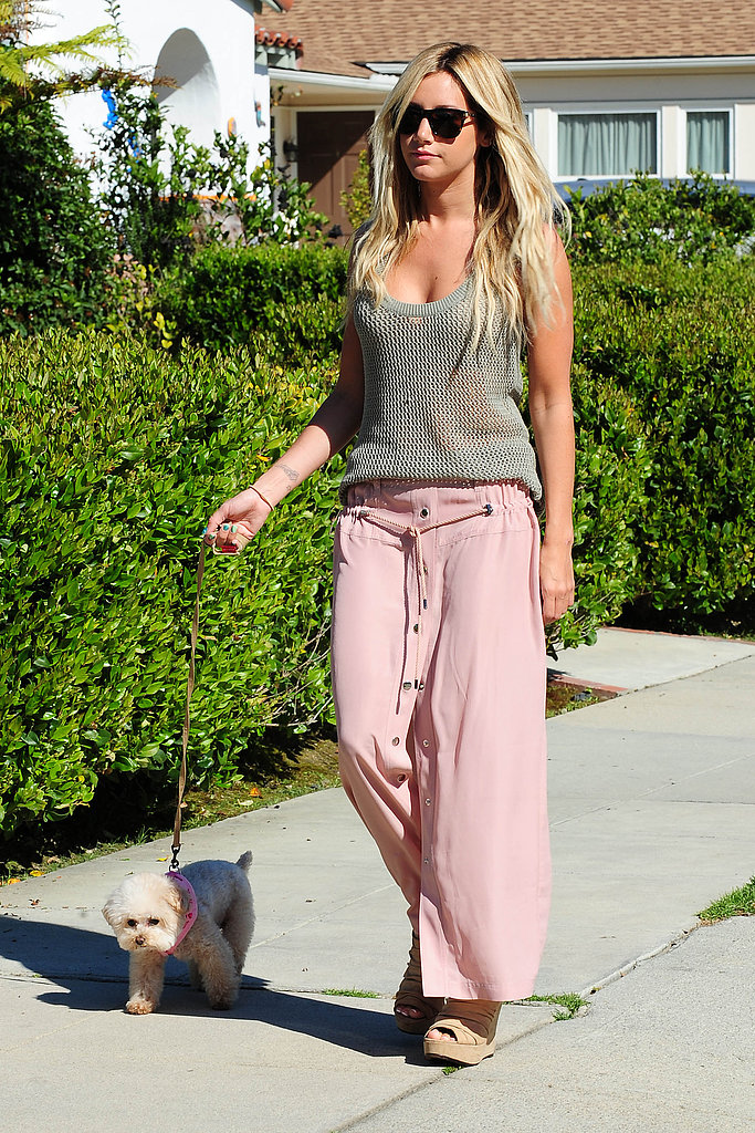 While walking her dog in LA, Ashley Tisdale showed off her Spring style in a knit tank and pink drawstring maxi skirt, both by Derek Lam for DesigNation.