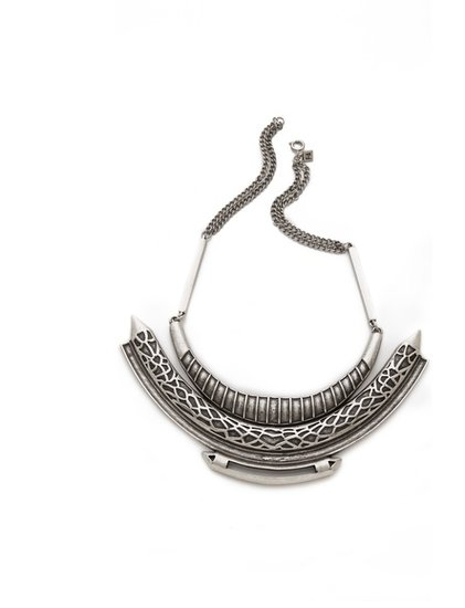 Give your blouses and dresses an edgy update with this Feliks + Adrik Python Bib Necklace ($99, originally $198).