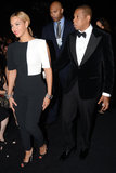 Beyoncé was on-trend in a black-and-white Osman jumpsuit and Jay-Z was polished in a black tuxedo at the 2013 Grammy Awards.