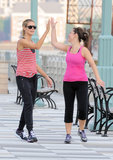 Heidi Klum shared a slap with a friend in NYC in June 2011 after a run.