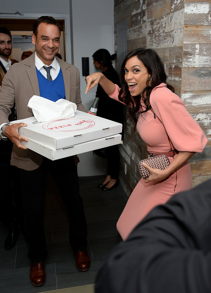 Rosario Dawson got happy when pizza arrived at the Trance afterparty.