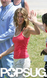 Jennifer Aniston gave a crew member some skin on the set of The Break-Up in Chicago in June 2005.