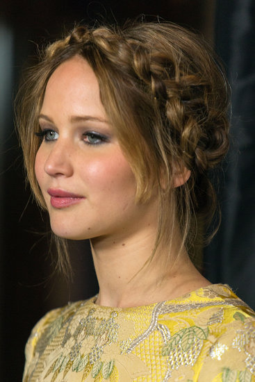 Jennifer Lawrence's milkmaid braid was the top pick among all the celebrity updos we rounded up with brides in mind.