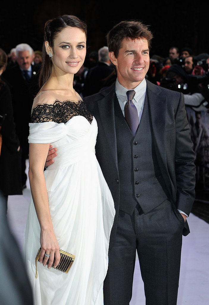 Tom Cruise and Olga Kurylenko posed together on the white carpet.
