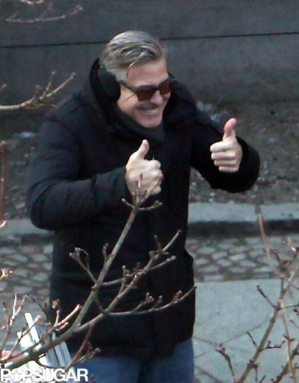 George Clooney gave two thumbs up on the set of The Monuments Men in Berlin on Thursday.