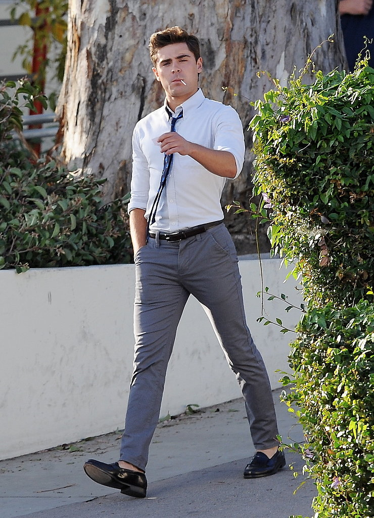 Zac Efron sucked on a lollipop while shooting scenes on the set of Townies in LA on Friday.