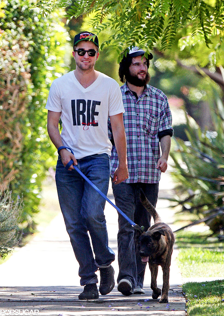 Robert Pattinson took Bear, who he adopted in New Orleans, for a guys' walk in LA in July 2011 with Tom Sturridge.