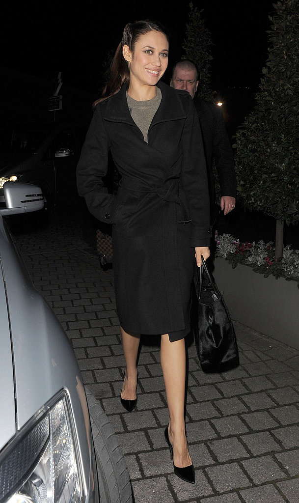 Olga Kurylenko donned a black coat.