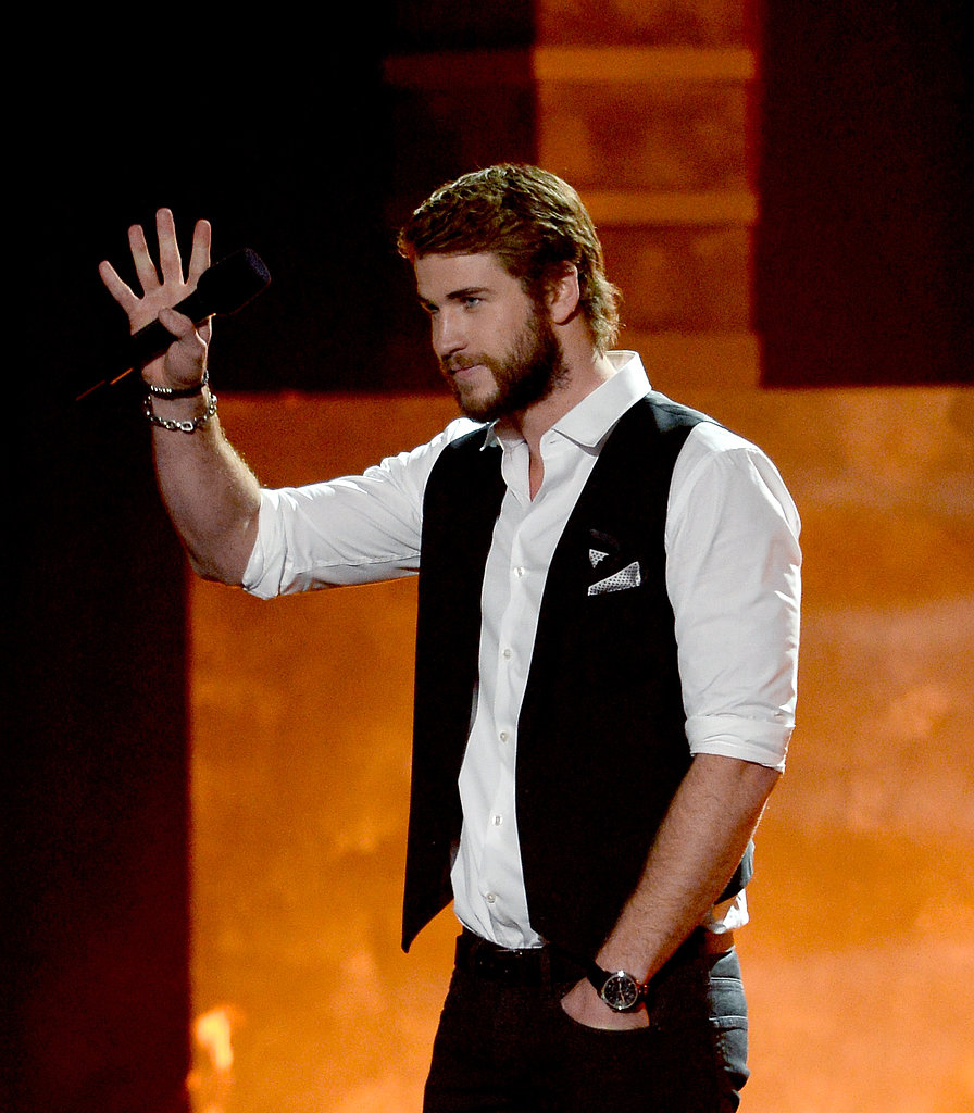 Liam Hemsworth waved from the stage.