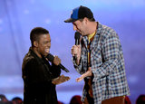 Funny men Chris Rock and Adam Sandler shared a moment on stage.
