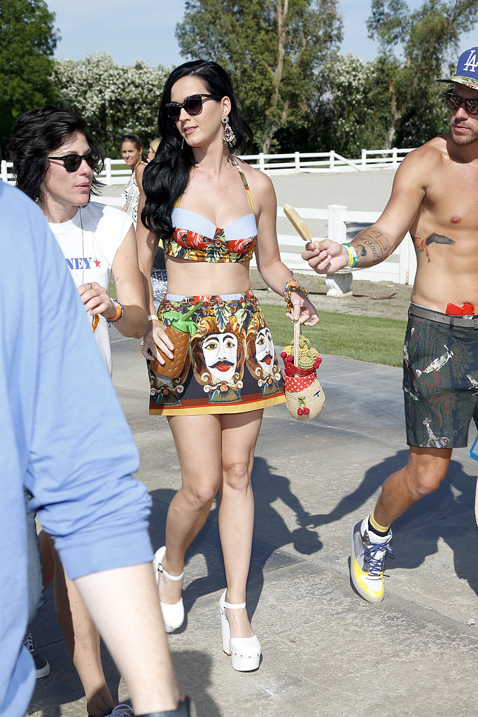 Katy Perry showed skin en route to the Lacoste L!ve Coachella Desert Pool Party.