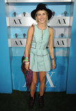 Julianne Hough posed fashionably in a minty fit-and-flare A/X Armani Exchange dress, combat boots, and a black wide-brim hat at the A|X Armani Exchange Neon Carnival at Coachella.  Photo courtesy of Seth Browarnik/WorldRedEye.com