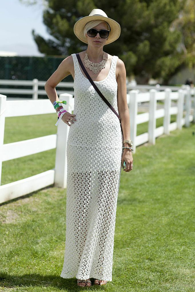 A chic festival party look comprised a bohemian knit maxi dress and chic accessories.