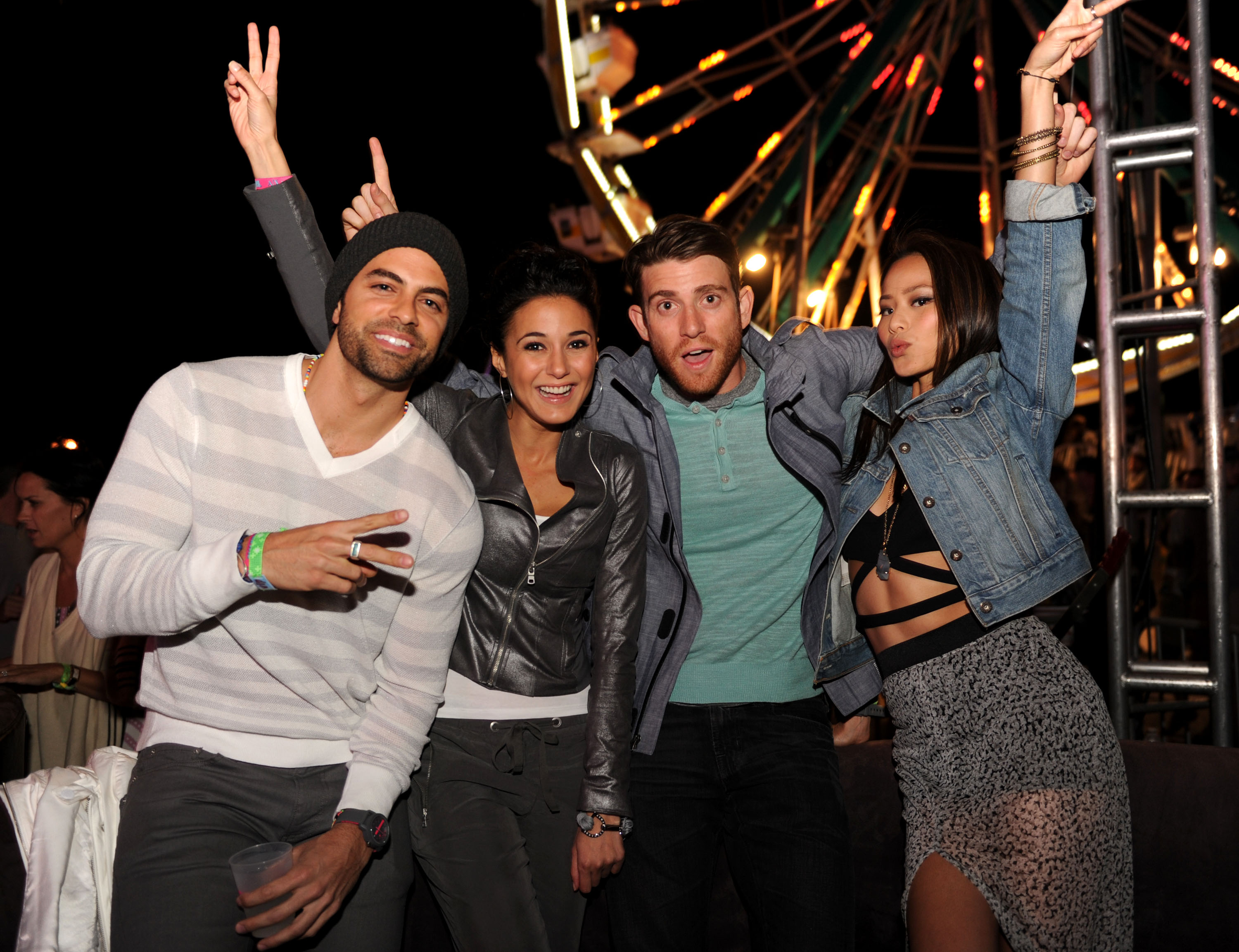 Emmanuelle Chriqui looked tough in a leather jacket, and Jamie Chung went laid-back in denim while getting goofy with friends at the A|X Armani Exchange Neon Carnival.  Photo courtesy of Seth Browarnik/WorldRedEye.com
