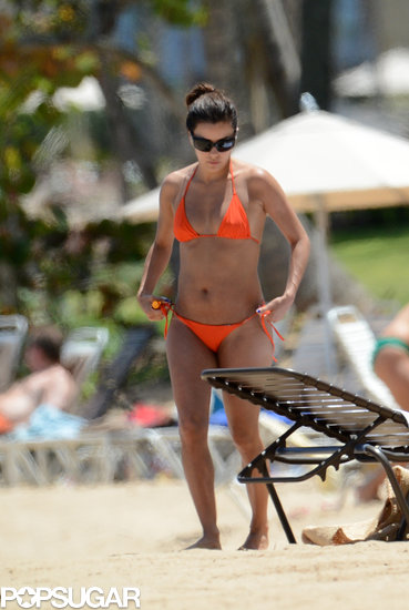 Eva Longoria slipped on an orange bikini for some rest and relaxation on the beach in Puerto Rico. Source: INF/Splash