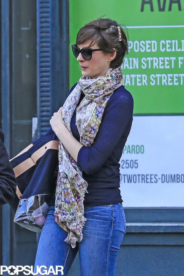 Anne Hathaway accessorized with floral accents in Brooklyn on Monday.