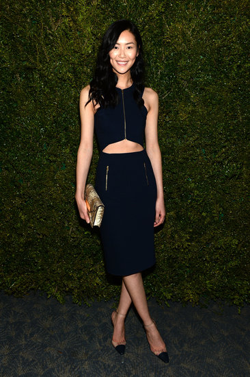 Liu Wen donned an all-black Michael Kors ensemble consisting of a crop top, pencil skirt, and metallic gold clutch.