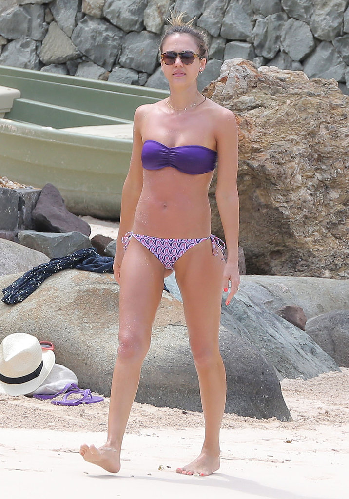 Jessica mismatched a purple bandeau bikini top by Milk the Goat ($90) with printed bottoms in St. Barts.