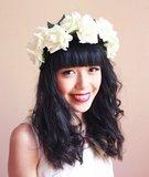 For the bohemian beach or farm wedding, finish off your hippie look with this ivory rose wedding headpiece ($39) from Etsy seller kisforkani.