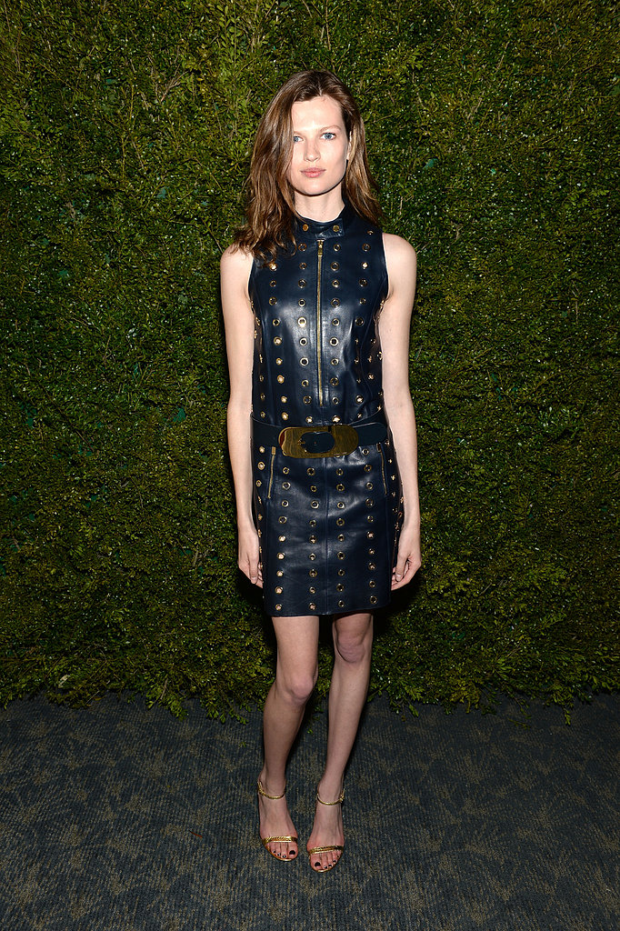 Model Bette Franke opted for a more subversive look in a studded black leather shift dress and metallic sandals.