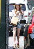Emma Roberts picked up a couple juices in LA wearing a checkered blouse with denim cutoffs, a wide-brim fedora and tan ankle boots.