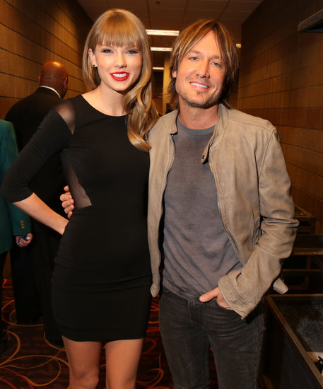 Taylor Swift and Keith Urban posed backstage.