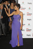 Halle Berry's baby bump could been seen under her purple gown.