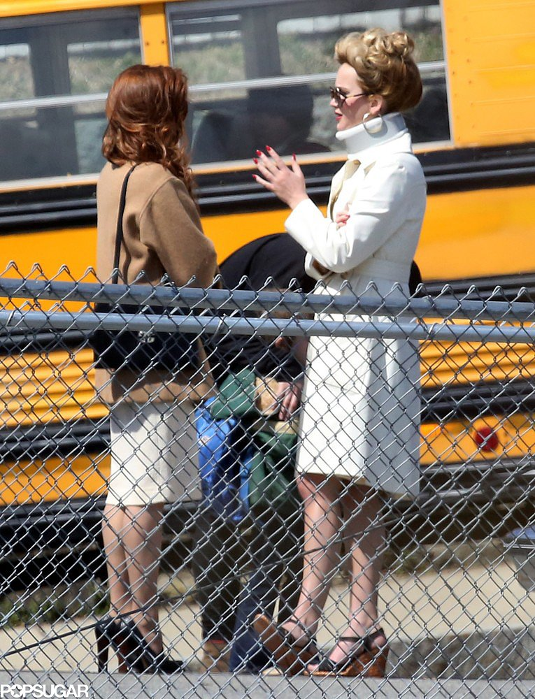 Jennifer Lawrence wore a neck brace while chatting with Amy Adams on set in Boston.
