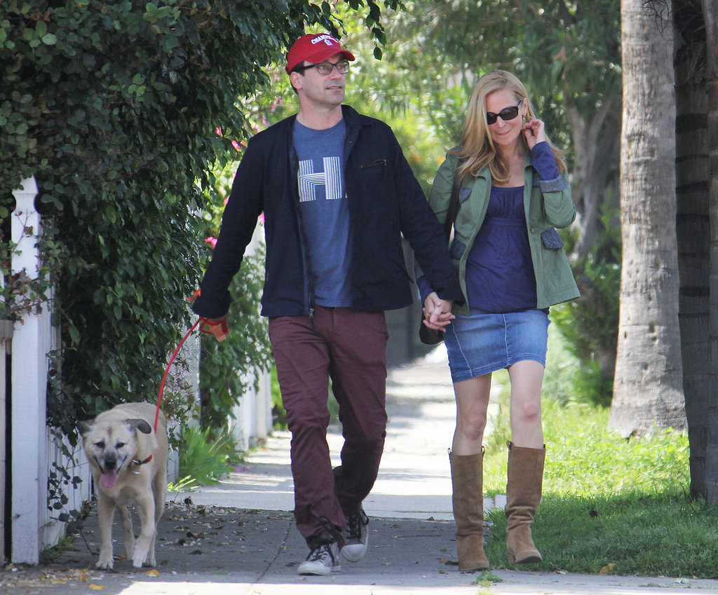 Jon Hamm held onto his two leading ladies, longtime girlfriend Jennifer Westfeldt and their dog Cora, during a walk in LA in March 2013.