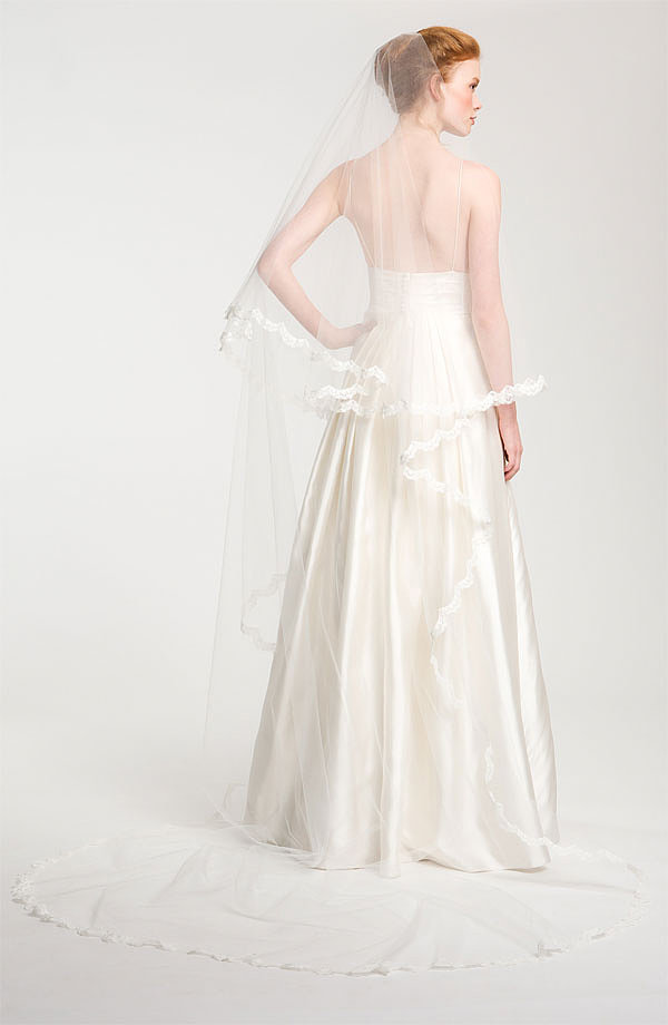 Lace detailing adds an extraromantic touch to this Nina Angela cathedral veil ($1,250).